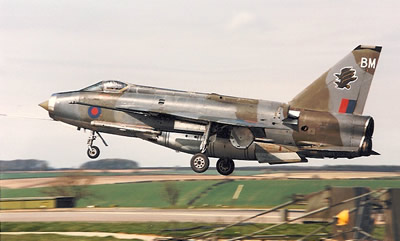 F'6 XS898 'BM' in camouflage flies slowly down the Binbrook